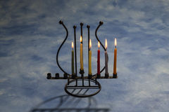 Five burning Hanukkah candles in Menorah Stock Photos