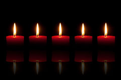 Five burning red candles Royalty Free Stock Photo