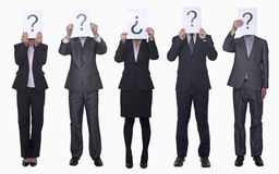Five business people holding up paper with question mark, obscured face, studio shot Royalty Free Stock Photos