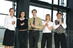 Five business persons are clapping their hands Stock Photography