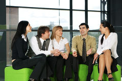 Five business persons are having a conversation Royalty Free Stock Images