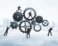 Five businessman runs gears Royalty Free Stock Photography