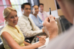 Five businesspeople at boardroom table. Business team in boardroom meeting Royalty Free Stock Photo