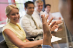 Five businesspeople at boardroom table Stock Photo