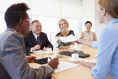 Five Businesspeople Having Meeting In Boardroom Royalty Free Stock Images