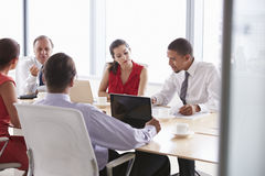 Five Businesspeople Having Meeting In Boardroom Royalty Free Stock Photography