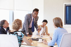 Five Businesspeople Having Meeting In Boardroom Royalty Free Stock Photos
