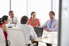 Five Businesspeople Having Meeting In Boardroom Stock Image