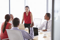 Five Businesspeople Having Meeting In Boardroom Stock Photo