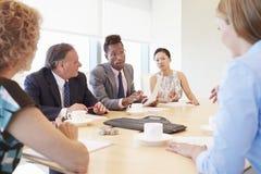 Five Businesspeople Having Meeting In Boardroom Royalty Free Stock Photo