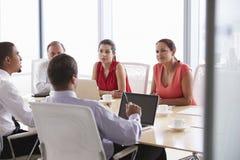 Five Businesspeople Having Meeting In Boardroom Royalty Free Stock Image
