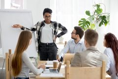 Five businesspeople at seminar in conference room stock photo