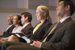 Five businesspeople smiling in presentation royalty free stock photo