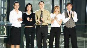 Five businesspersons are clapping their hands Stock Photo