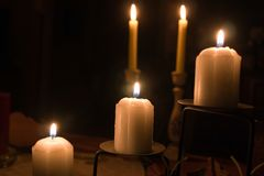 Five candles. Candles glowing in the dark Stock Photos
