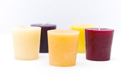 Five candles. Five multi-colored candles are not, on a white background, side view stock photography