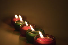 Five candles. Five red and green lit little candles in a row. Christmas colors Royalty Free Stock Photo