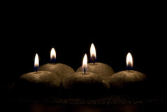 Five candles on a black background Stock Photography