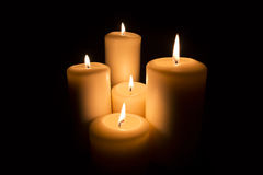 Five Candles on black background Royalty Free Stock Photos