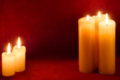 Five candles on carmine Stock Images