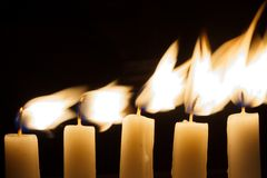 Five candles in the dark Royalty Free Stock Image