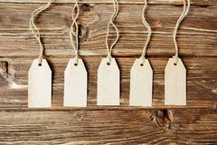 The five card badges with ropes on wooden table