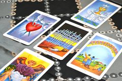 Tarot Cards  Five card Spread Ten of Swords. Five card spread displayed on a table.Tarot cards based on the Rider-Waiter system. 10 of swords card in the center Royalty Free Stock Image