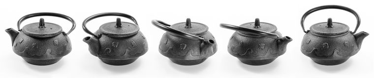 Five cast-iron teapots  in different angles on white background Royalty Free Stock Photo