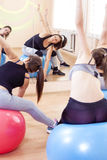 Five Caucasian Female Athletes Having Stretching Exercises. Sport, Fitness, Healthy Lifestyle Concepts. Group of Five Caucasian Female Athletes Having Stretching Stock Photos