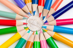 Five cent coin and pencils Stock Photo