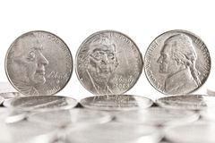 Five Cents. Three five cents Coins standing on the edge white background and coins on the foreground Stock Image