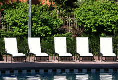 Five chaise lounge chairs. By the pool Stock Image