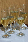 Five champagne glasses on a table. Royalty Free Stock Image