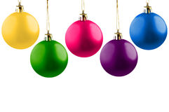 Five cheerful Christmas balls. Stock Photos