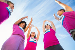 Five cheering runners supporting breast cancer marathon Stock Photography