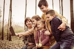 Portrait of four children in the park. royalty free stock image