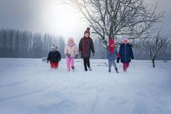 Group of children in the snow. royalty free stock images