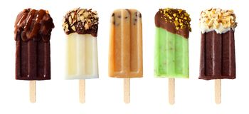 Five chocolate themed popsicles isolated on white. Five assorted chocolate themed popsicles isolated on a white background Royalty Free Stock Photography