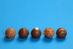 Five chocolate truffles in a row Royalty Free Stock Photography