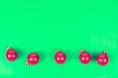 Five Christmas balls crimson color Royalty Free Stock Image