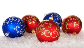 Five christmas balls with pattern. On snow on white background Royalty Free Stock Photo