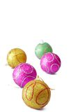 Five Christmas baubles on white background. Five Christmas baubles - pink, yellow and green on white backgound Stock Photos