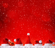 Five Christmas hats . Five Christmas hats  isolated on red background Stock Photography