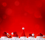 Five Christmas hats . Five Christmas hats  isolated on red background Royalty Free Stock Photography