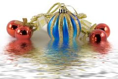 Five christmas spheres. In water stock photography