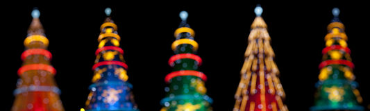 Five christmas tree in the night Stock Photography