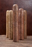 Five cigars. On a dark background Royalty Free Stock Photography