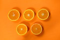 Five circles of orange on an orange background. stock photos
