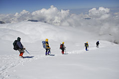 Five climbers trekking down stock image