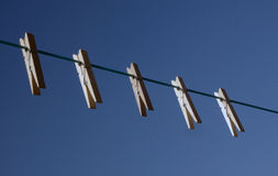 Five clothespin on a. Washing line Stock Photo